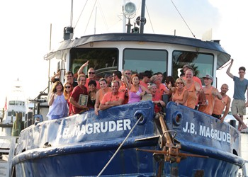 Capt. Andy Matroci with crew, family & friends on salvage vessel J.B. Magruder.